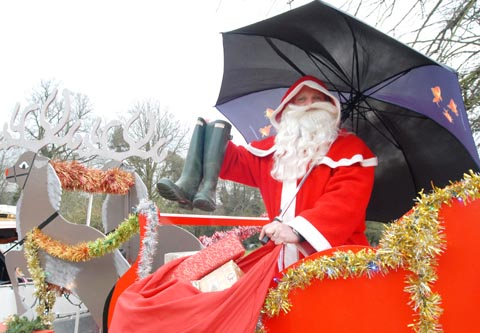 Kinver Rotary Club's Santa with his brolly and wellies ready to head out on his sleigh whatever the weather. Buy photo: 491252M