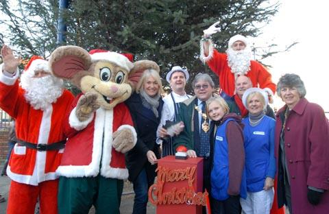 l-r  Santa, Riley,Margot James, Mark Cooper, Mayor Mottram, Elizabeth Almond, Stilts Santa, leading Stourbridge retail manager David Harcourt , Lesley Almond from event sponsors Ocean Seafood, Mayoress Michelle Mottram