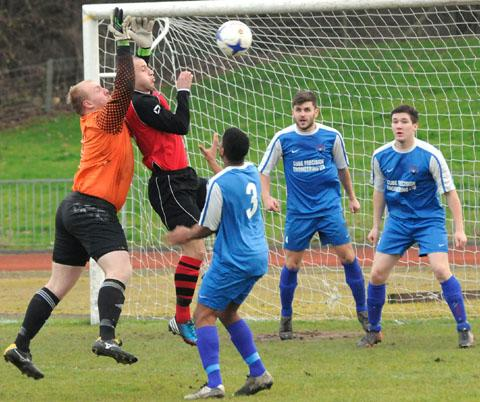 Cradley keeper Matt Jones and Dudley's Danny Ludlow challenge for the ball during last Saturday's game