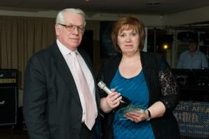 Sandra Skirving received her long service award from John Uffold, chairman of McCartneys.