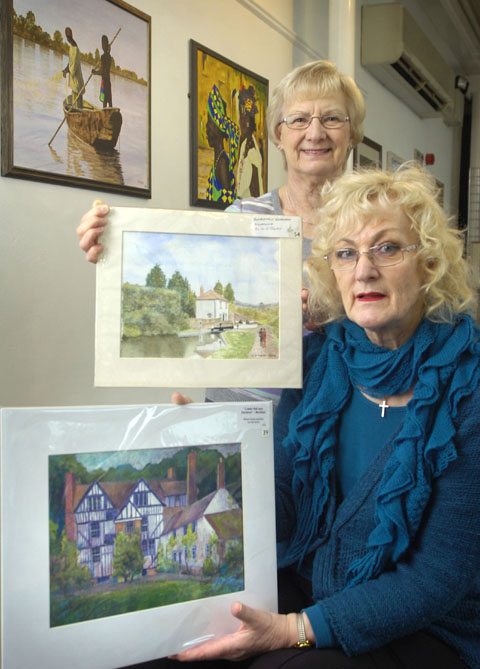 Artists Elaine Smith (front) & Ena Baker (not holding their own work). Buy photo: 041303L