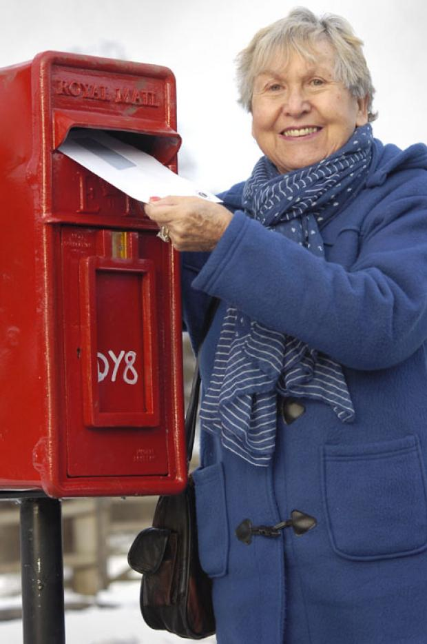 Cllr Pat Martin with the newly reinstated post box in Amblecote.