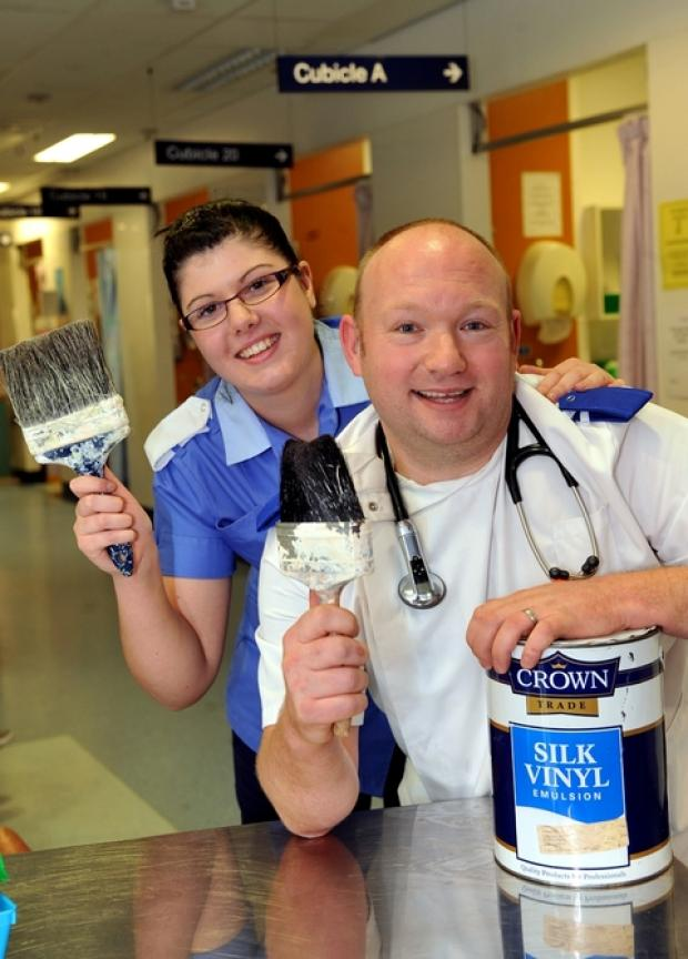 Staff nurse Lucy Edmunds and charge nurse Matthew Walker get their paint brushes ready to redecorate the residents' room.