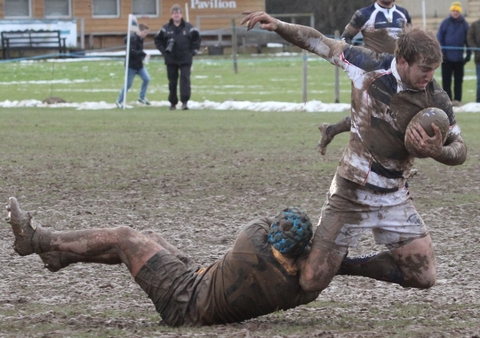 Stour's Ben Barkley is pulled down in the Luctonians mud