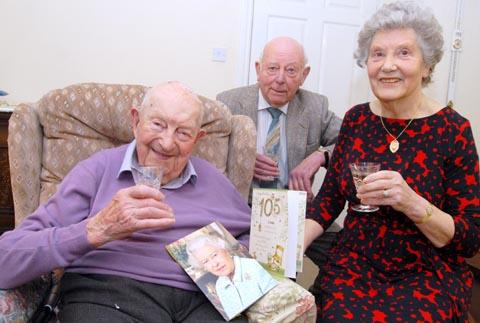 Jack Jones celebrates his 105th birthday with relatives. Buy photo: 071319M