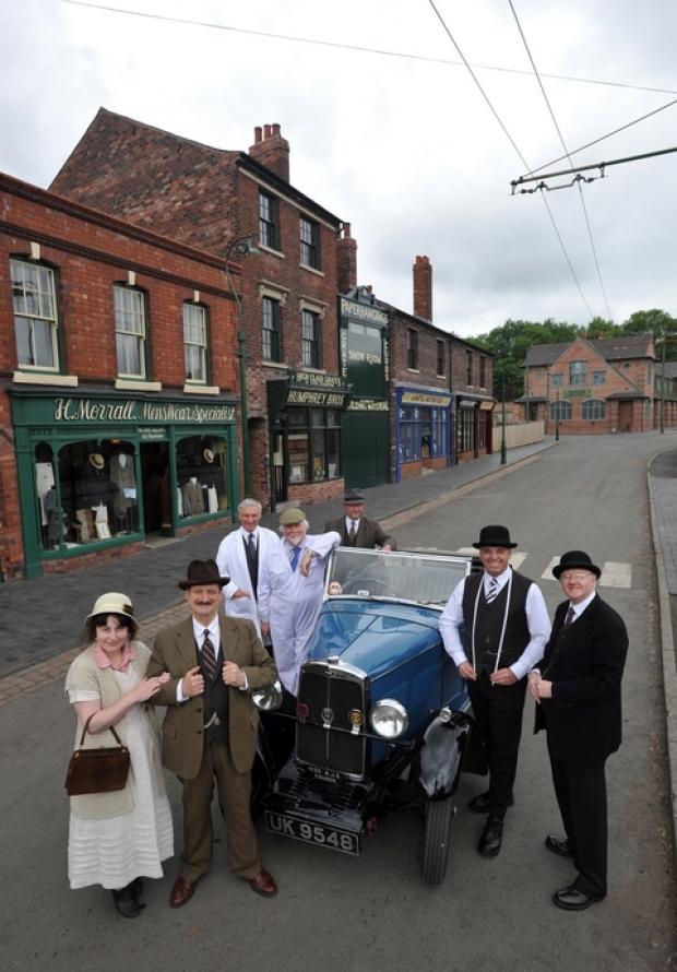 The Museum's Vehicle Volunteer group pictured with a 1930 AJS Tourer
