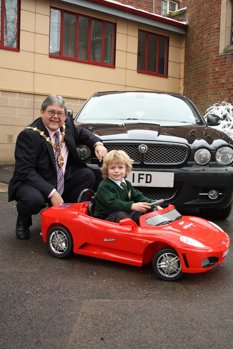 Councillor Melvyn Mottram, Mayor of Dudley, with grandson, Zachary Mottram, aged three, try out the donated giant remote controlled car