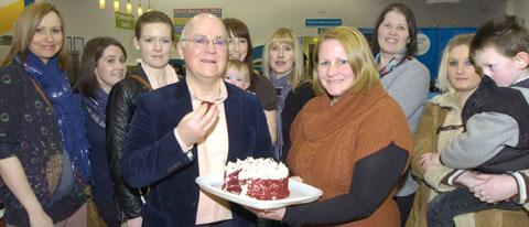Brendan Lynch tastes Pauline Vaughan's winning red velvet cake with members of Merry Hill's Mummy Mornings. Buy photo: 091318L