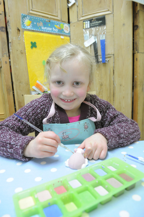 Hannah Shaw, aged five, trying her hand at pottery painting at the cone.