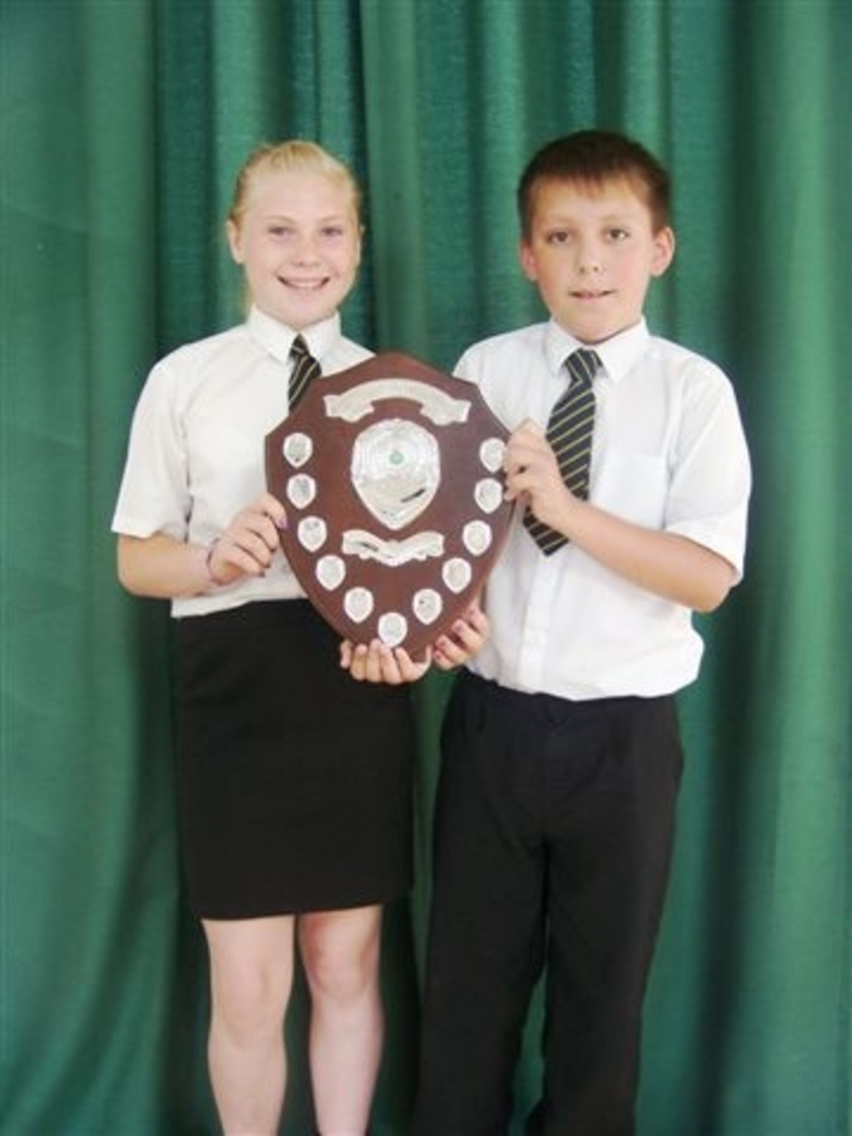 Inspirational youngsters: St Oswald's Primary School students Lucy Williams, 11 and Jordan Joslin, 10, hold the young citizen's challenge shield.