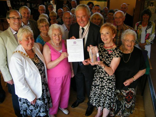 Volunteers were presented with their award and certificate by the Queen's Deputy Lieutenant, Peter Tomlinson.