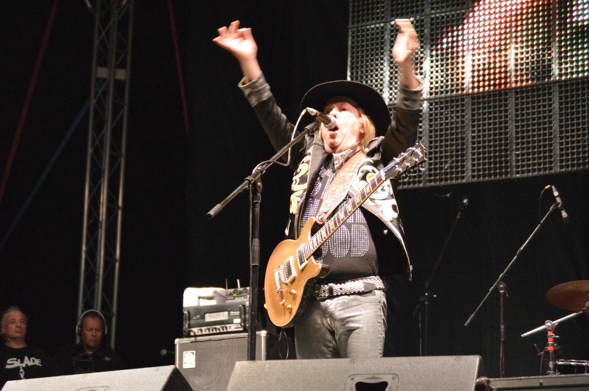 Dave Hill from Slade onstage at Upton 2013