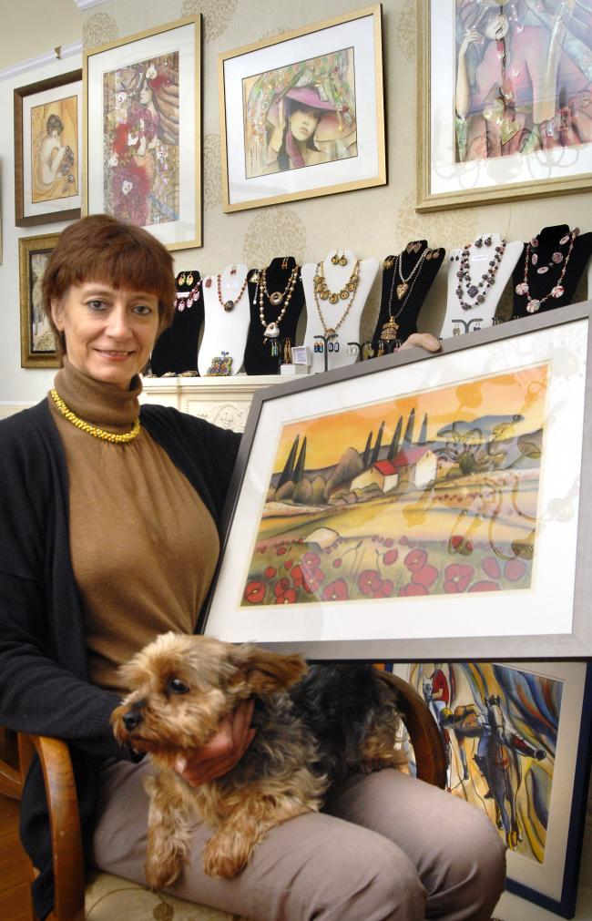 Pascale Bigot with her dog Gribouille and artwork. Buy photo: 441307L
