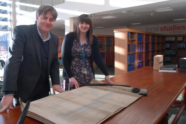 Cllr Stuart Turner with archivist Helen Donald celebrate the opening of Dudley Archives and local history centre.