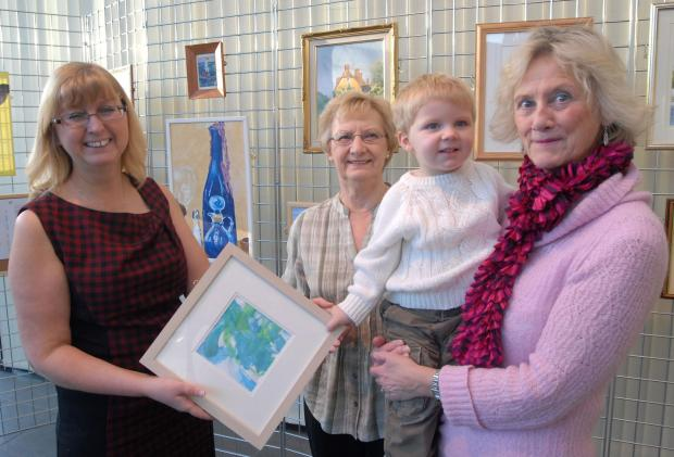 Stourbridge News: Brierley Hill Society of Artists exhibition at the cone: l-r Lillian Goodwin, Ena Baker, Oliver Jones, aged two and Helen Brettle. Buy this photo: 041401M.