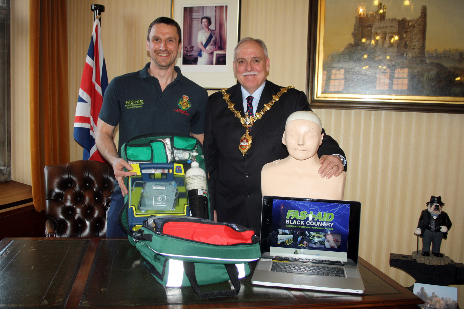Paul Grove from FastAid poses with lifesaving equipment and teaching equipment with the Mayor of Dudley cllr Alan Finch.
