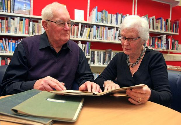 Stourbridge News: Historian Mike Dewey and Jill Hackett with the Clarkson Rose diaries that look set to return to Dudley