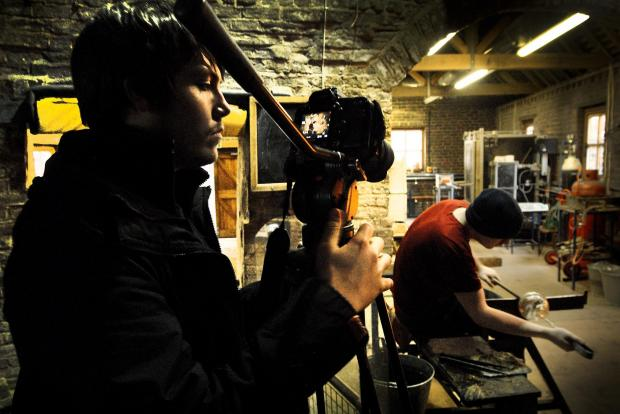 David Toms, left, filming glass-maker Darren Weed at the Red House Glass Cone. Buy photo: 071421L