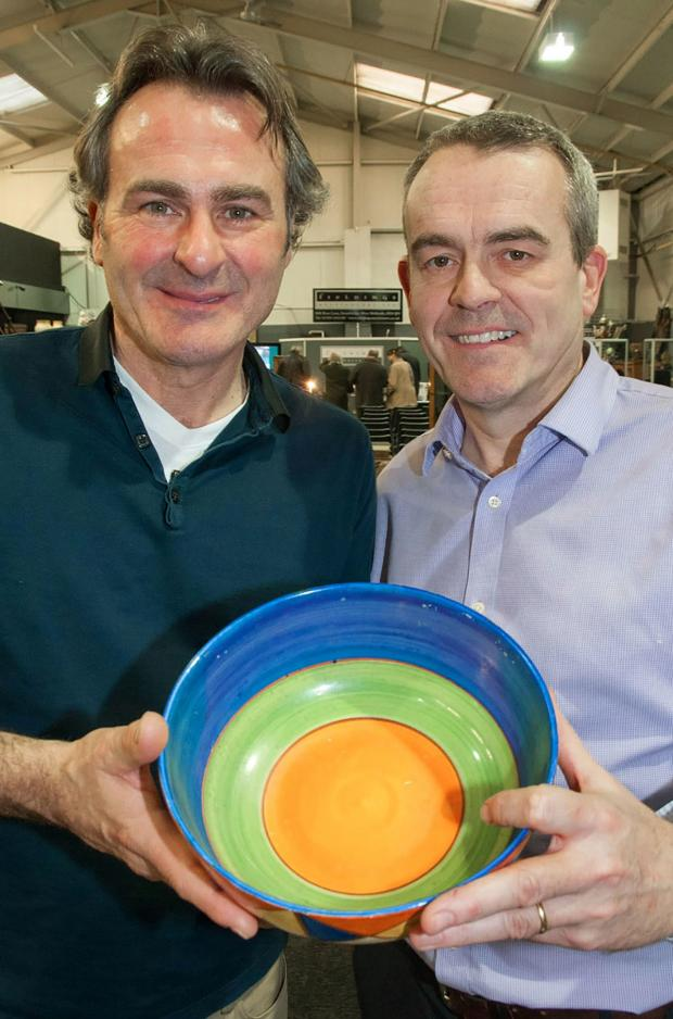 Stourbridge News: L-r Flog It! presenter Paul Martin with Nick Davies of Fieldings Auctioneers - checking out a Clarice Cliff bowl. Buy photo: 071412MH