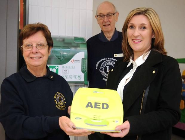 (L-R) Mary Thompson, vice president of Kingswinford and Stourbridge Lions, Lion - Graham Foster, and Ryemarket centre manager Kelley Dyas with the new defibrillator installed in the centre. Buy photo: 081413ET