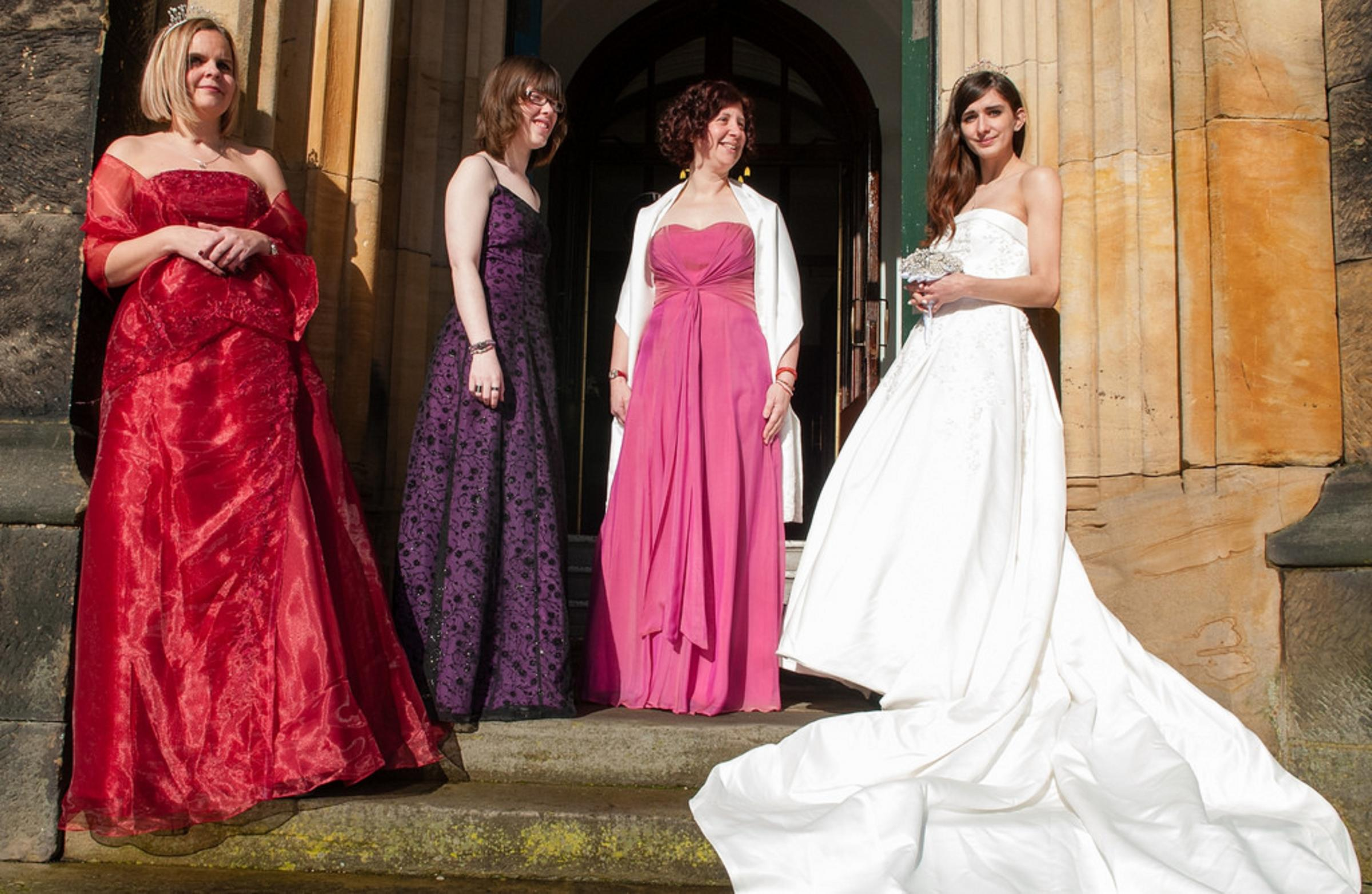Modelling some of the wedding outfits for sale, left to right - Kerry Payne