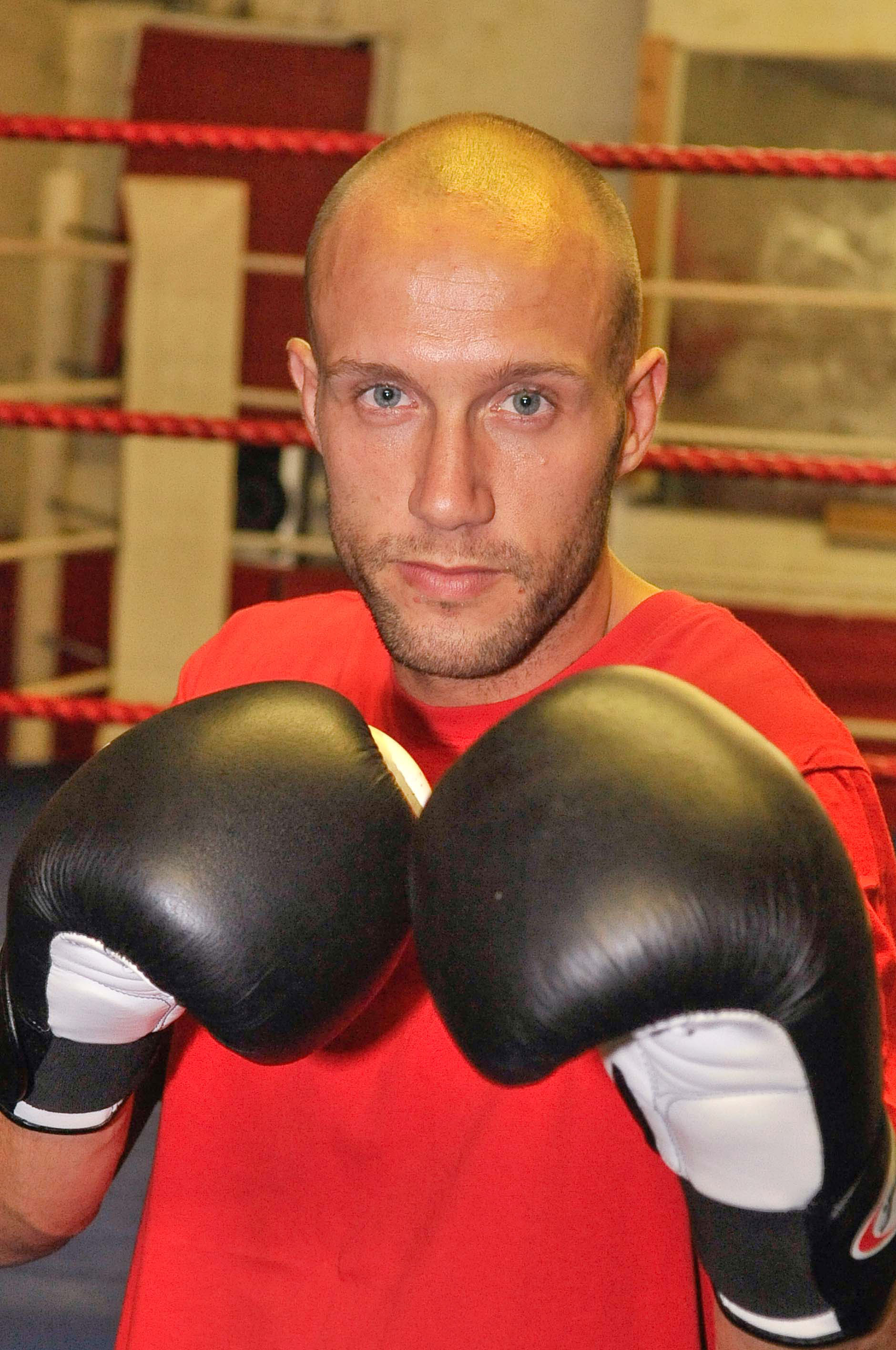 Amatuer boxer Shane Davies kept his football career alive by taking on a false identity - and then slapped a ref and broke his nose