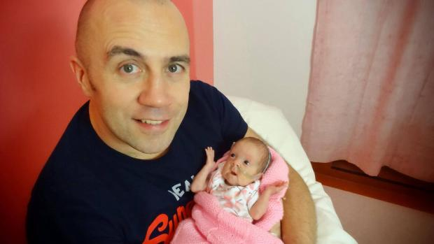 Stourbridge News: Wayne Little cradles miracle daughter Daisy-Mae