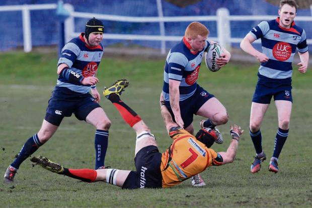 Stourbridge News: Harry Bayliss fends off a tackle (4357574)