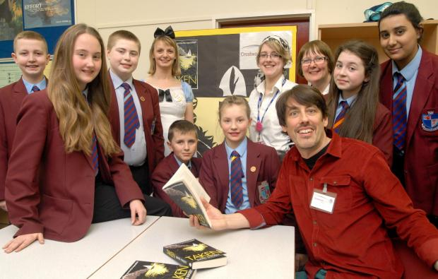Stourbridge News: David Massey with students and staff at Crestwood School. Buy photo: 111407L