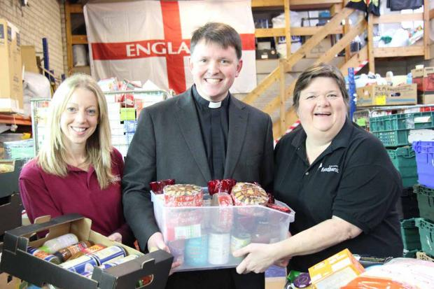 Canon Graham Usher with Jen Coleman, office manager at Foodbank, and former Foodbank CEO Wendy Fryatt pictured in December when the new Bishop first visited the borough.