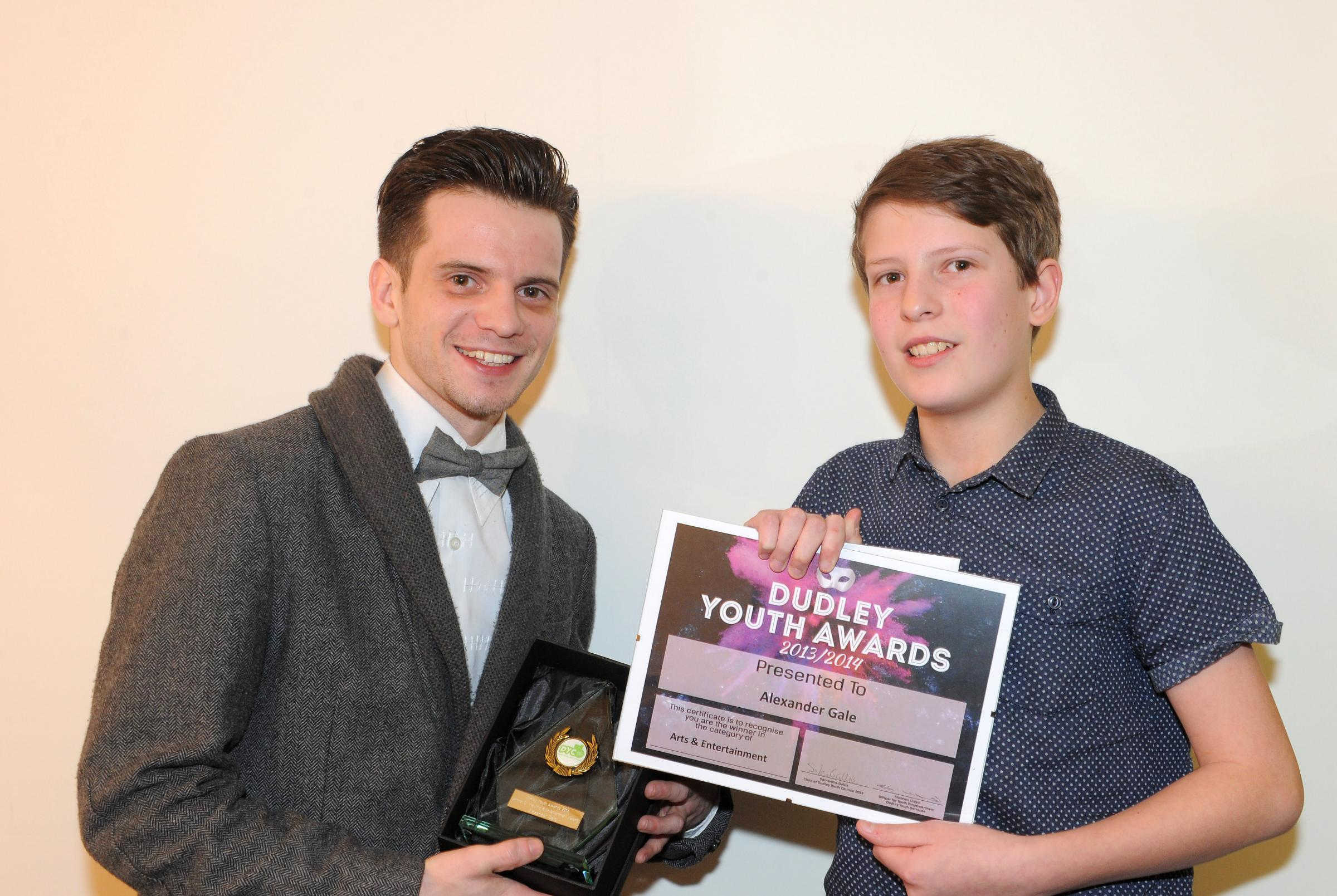 Redhill student Alexander Gale, right, being presented with his award by Matt Windle, Birmingham's young poet laureate in 2007/8 who works with young people across the borough.