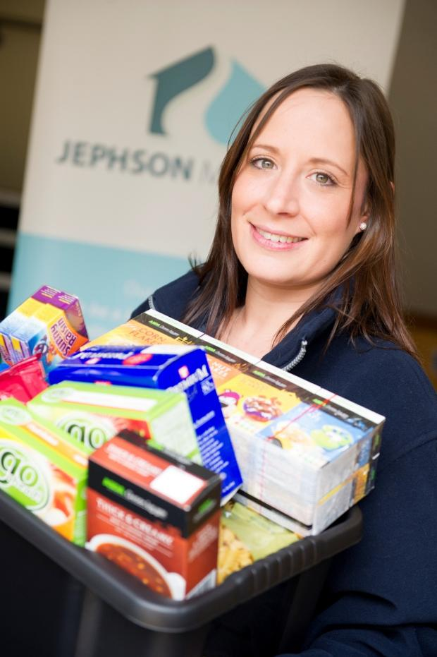 Stourbridge News: Keira Lymath with a box of long-life foods and toiletries ready to be donated to a foodbank.
