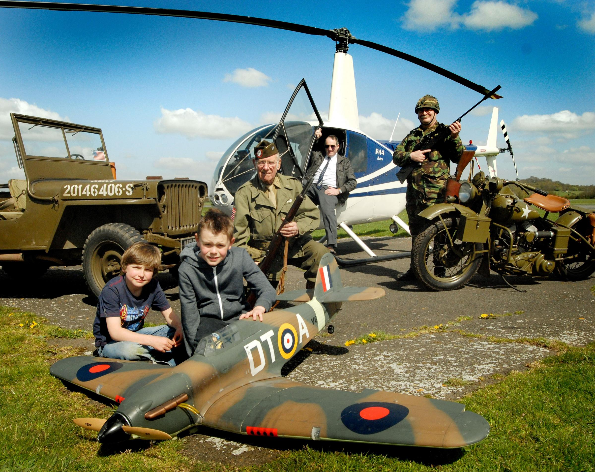Josh Richards (10) and Henry Burton (9) with a model Hurricane fighter, John