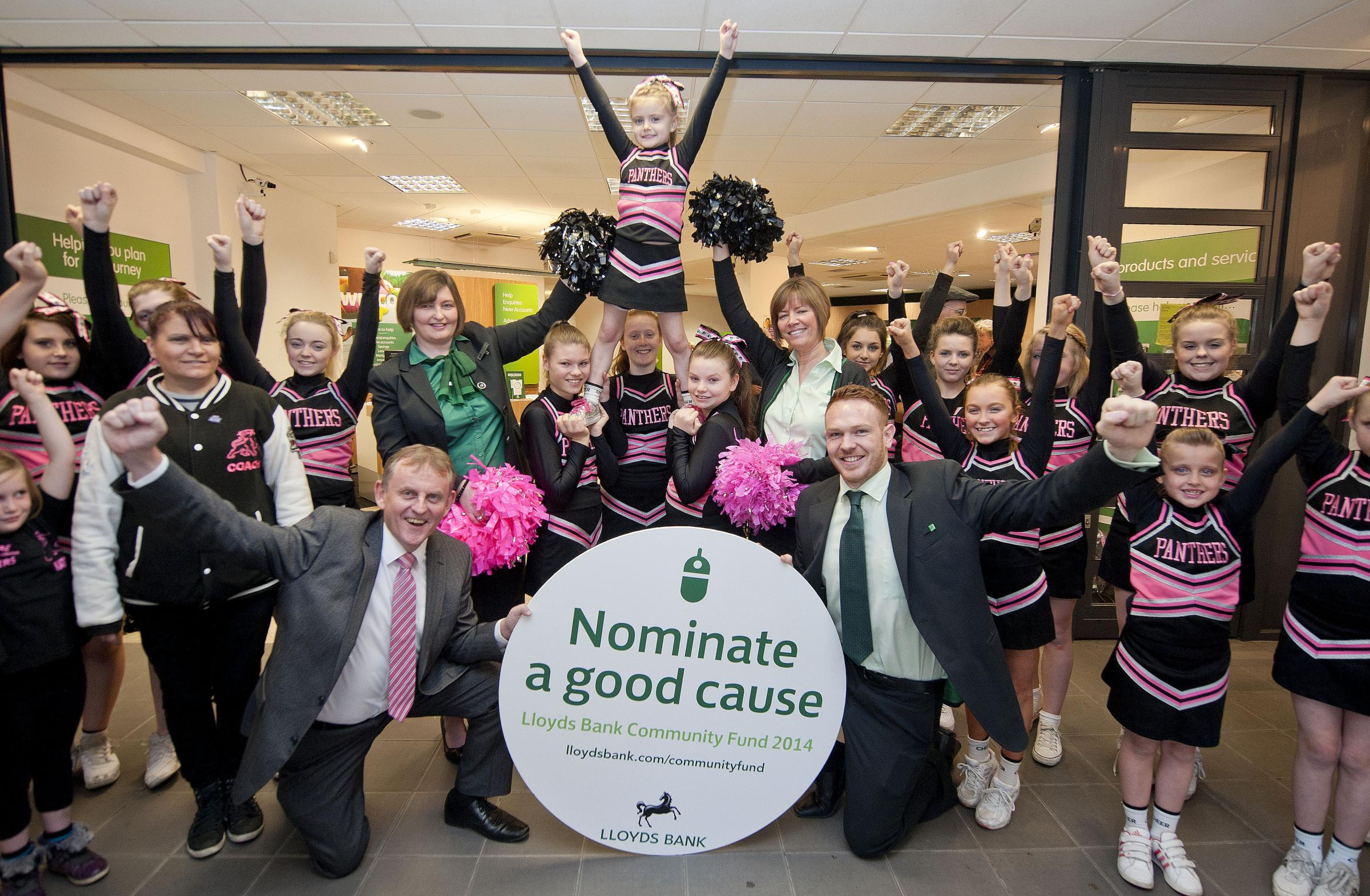 Lloyds Bank staff (left to right) - Brian Cartwright, commercial senior manager; Nicola Hartland, customer service assistant; Beverley Hassan, customer service assistant; and Lawrence Breese, personal banking advisor; with Pedmore Panthers cheerleaders.