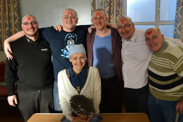 L-r: Nathan Westwood, Alistair Westwood, Nathan Jones, Andy Westwood and Alan Westwood with Imogen at the sponsored head shave.