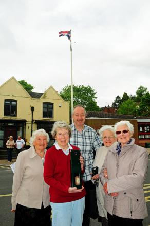 L-r - Chris Furness, Barbara Staniford, Pam Hutton and Helen Bannister flew the flag in Kinver High Street to mark the 50th birthday of mobile fishmonger Jonathan Spencer - centre. Pic by Graham Gough.