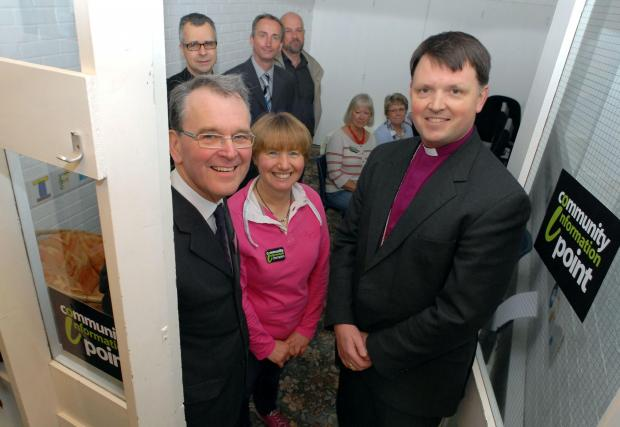 Bishop of Dudley Graham Usher opens the Community Information Point in Norton. L-r Peter Dyson, Dale Walker and Bishop Graham Usher. Buy this photo: 201416M.