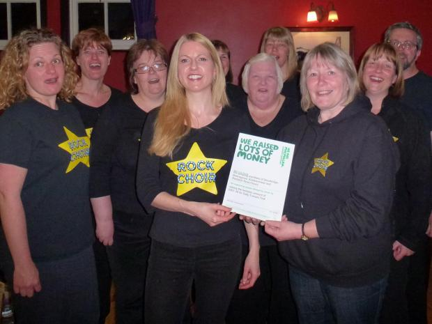Stourbridge Rock Choir leader Christa Hugo, front centre, with charity trek veteran Sally Turner, and choir members.