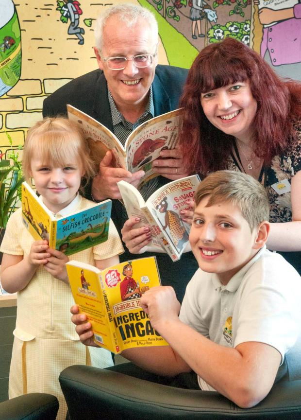 Stourbridge News: L-r Harriet Marie Smith, Joanne Tippler Dudley Council, Ray Dyer of Peters Books, Ethan Meaden. Buy photo: 211408MH
