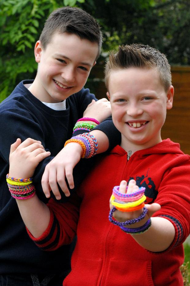 Stourbridge News: Brothers Ethan and Hayden Dunbar-Baker have made bracelets to raise funds for Cancer Research in memory of their gran.