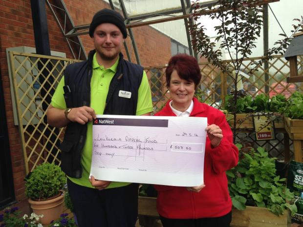 Sam Oliver from Barnett Hill Garden Centre presented the cheque to Pauline Jenkins from the Leukaemia Unit Appeal Fund.