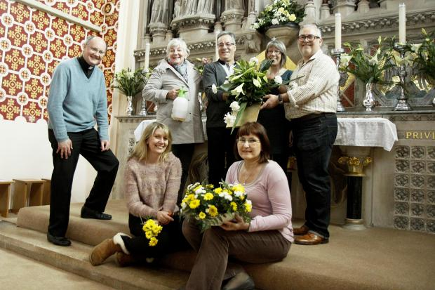 Preparing for the flower festival back l-r  Father Pat McKinney, Marilyn Baker, Mervyn Lodge, Anna Morley and Steve McNally and front l-r Lisa Sheldon and Anna Mela.