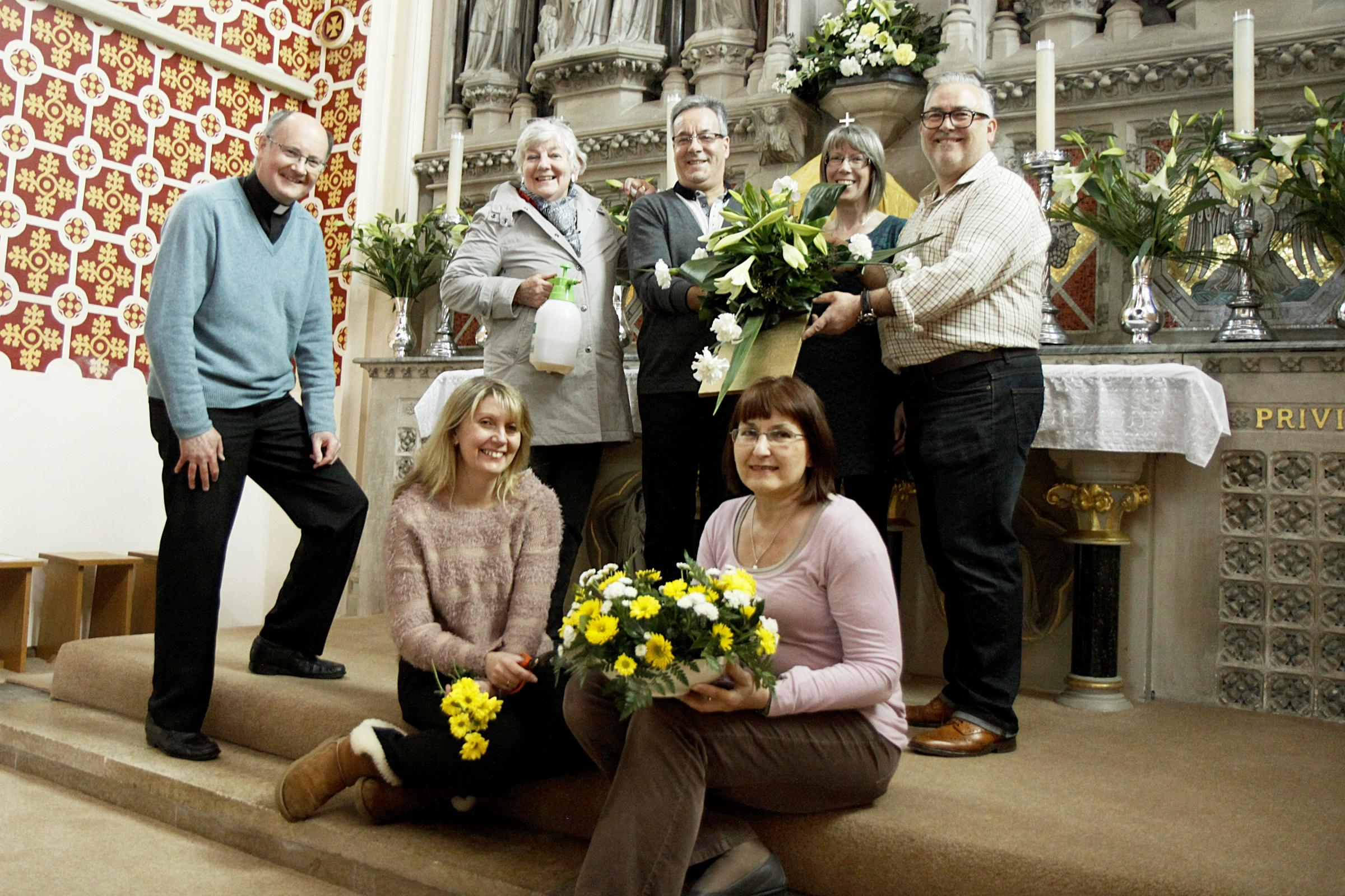 Preparing for the flower festival back l-r  Father Pat McKinney, Marilyn Baker, Mervyn Lodge, Anna Morley and Steve McNally and fron