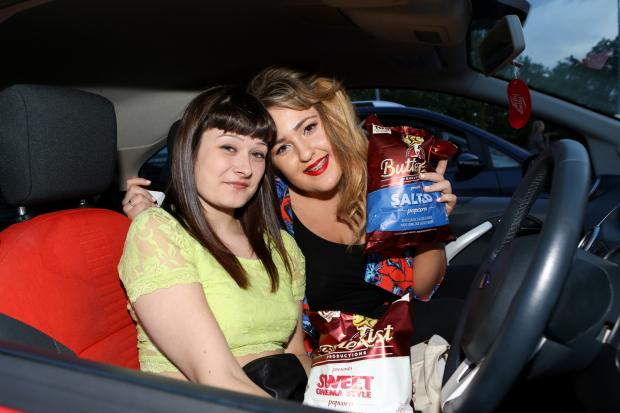 Stourbridge News: Marie Shucker and  Nicola Berkley from  Halesowen at the drive-in. Picture by Shaun Fellows / Shine Pix.