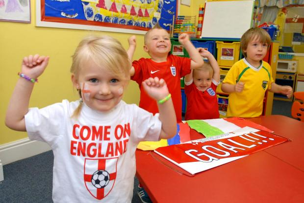 Stourbridge News: Early Years nursery World Cup party l-r Charlotte Smith (4), Ryan Freeman (4), Alivia Hancox-Parkes (2) and Dylan Smith (4). Buy this photo: 251404M.