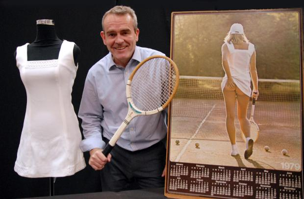 Auctioneer Nicholas Davies with the famous Tennis Girl dress and racquet which will go under the hammer at Fieldings Auctioneers on July 5. Buy photo: 261492M