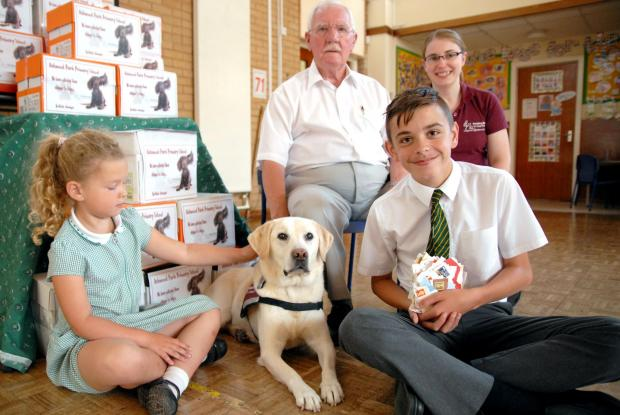 L-r Leah Guest, aged six, hearing dog Dorree, Howard Hodgkisson, Josh Lambert, aged 11 and Vicky Ryan. Buy this photo: 261494M.
