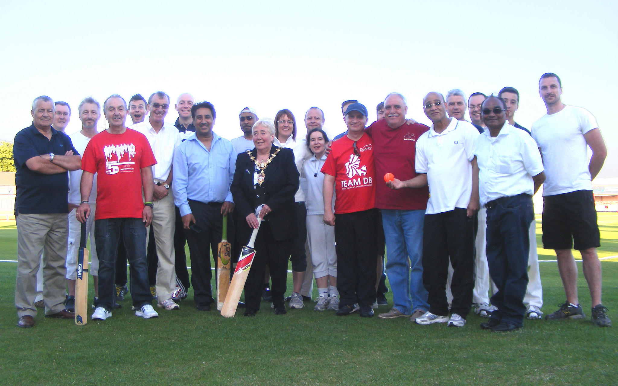 Councilors and officers at the charity cricket mat