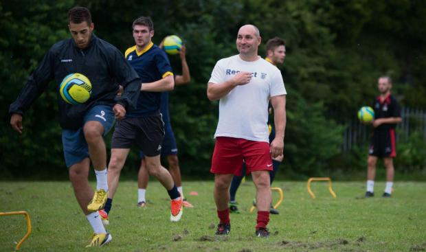 Stourbridge News: l Manager Ian Long oversees the start of pre-season training. Photo courtesy of Tividale FC