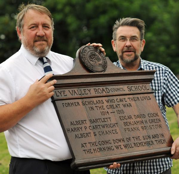 L-r Teacher Paul Reynolds and technician Les Bate with the memorial plaque. Buy thi